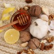 Stock Photo: Healthy ingredients for strengthening immunity on warm scarf close-up