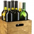 Wine bottles in wooden box isolated on white — Fotografia Stock  #18133251