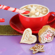 Cup of coffee with Christmas sweetness on purple background — Stock Photo #18133549