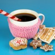 Cup of coffee with Christmas sweetness on blue background — Stock Photo #18133551