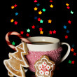 Cup of coffee with holiday candy on Christmas lights background — Stock Photo #18133567