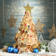 Beautiful christmas tree of dry lemons with decor, on shine blue background — Stock Photo #18133585