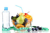 Glass bowl with fruit for diet, measuring tape and water bottle isolated on white — Stock Photo