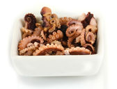 Tentacles of octopus in bowl isolated on white — Stock Photo
