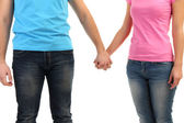 Loving couple holding hands isolated on white — Stock Photo