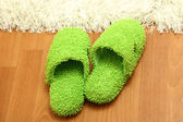 Bright slippers, on floor background — Foto Stock