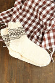 Warm knitted socks on wooden table close-up — Stock Photo