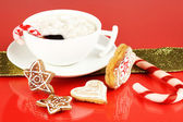 Cup of coffee with Christmas sweetness on red background — 图库照片