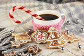 Cup of coffee with Christmas sweetness on plaid close-up — Photo