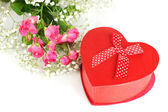 Giftbox and flowers isolated on white — Stock Photo