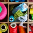 Thread and material for handicrafts in box close-up — Stock Photo #18169373