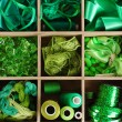 Stock Photo: Green thread and material for handicrafts in box isolated on white