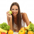 Beautiful young woman with fruits and vegetables, isolated on white — Stock Photo #18169531