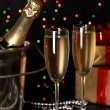 Celebratory champagne with stemware on Christmas lights background — Stock Photo #18169583
