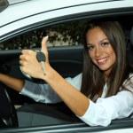 Beautiful young woman in car — Stock Photo #18169613