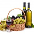Royalty-Free Stock Photo: Bottles and glasses of wine and grapes in basket, isolated on white