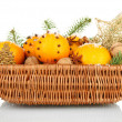 Christmas composition in basket with oranges and fir tree, isolated on white - Stok fotoğraf