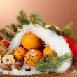 Christmas composition with oranges and fir tree in Santa Claus hat - Stok fotoğraf