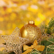 Christmas decoration on yellow background — Stock Photo