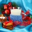 Cookies for Santa: Conceptual image of ginger cookies, milk and christmas decoration on blue background — Stock Photo #18169919