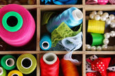 Thread and material for handicrafts in box close-up — Stock Photo