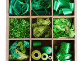 Green thread and material for handicrafts in box isolated on white — Stock Photo