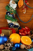 Composition from Christmas decorations on wooden table on wooden background — Stockfoto