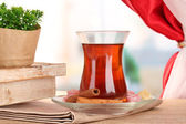 Glass of Turkish tea and rahat lokum, on wooden table — Stock Photo