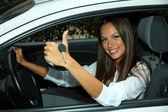 Beautiful young woman in car — Foto Stock