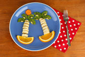 Fun food for kids on wooden background — Stock Photo