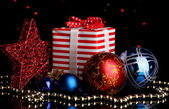 New Year composition of New Year's decor and gifts on Christmas lights background — Foto Stock