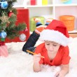 Little boy in Santa hat writes letter to Santa Claus — Stock Photo #18170041