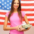 Young woman with American flag — Stock Photo #18170149