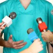 Stock Photo: Conference meeting microphones and doctor