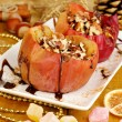 Baked apples on plate on wooden table — Stock Photo