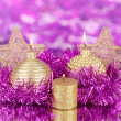 Christmas composition with candles and decorations in purple and gold colors on bright background — Stock Photo #18170435