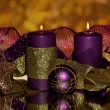 Christmas composition with candles and decorations in purple and gold colors — Stock Photo #18170445