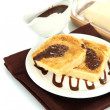White bread toast with chocolate on plate, isolated on white — Stock Photo