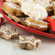 Christmas treats on plate isolated on white - Photo
