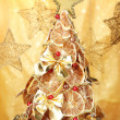 Beautiful christmas tree of dry lemons with decor, on yellow background - Stok fotoğraf