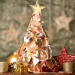 Beautiful christmas tree of dry lemons with decor, on grey background - Stok fotoğraf