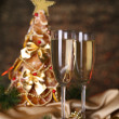 Beautiful christmas tree and  glasses of champagne on  shine grey background - Stok fotoğraf