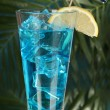 Blue Lagoon cocktail on  tropical background — Stock Photo