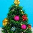 Decorated artificial Christmas Tree on blue background - Stok fotoğraf