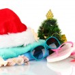 Beach accessories and Christmas tree isolated on white — Stock Photo #18171197