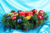 Beautiful Christmas wreath on blue fabric background — Foto de Stock