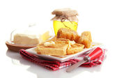 White bread toastwith honey on plate, isolated on white — Stock Photo