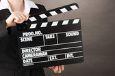 Movie production clapper board isolated on black — Stock Photo