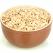 Brown bowl full of oat flakes isolated on white — Stock Photo #18272889