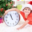 Little boy with clock in anticipation of New Year — Foto Stock #18274549